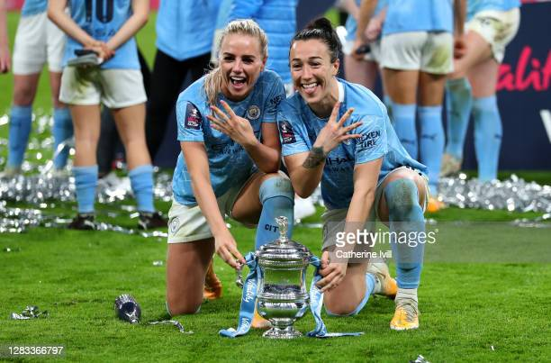 Alex Greenwood of Manchester City and Lucy Bronze of Manchester City celebrate with the Vitality Women's FA Cup Trophy following their team's victory...