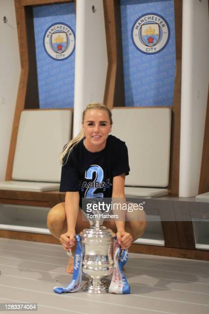 Alex Greenwood of Manchester City celebrates in the dressing room with the Vitality Women's FA Cup Trophy following her team's victory in the...