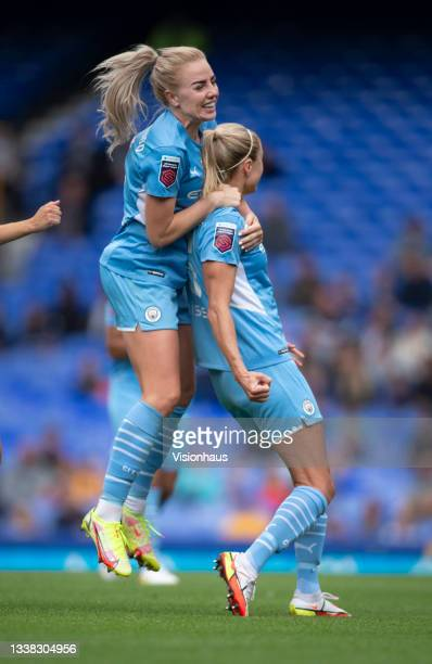 Alex Greenwood of Manchester City celebrates with their team's fourth goalscorer Steph Houghton during the Barclays FA Women's Super League match...