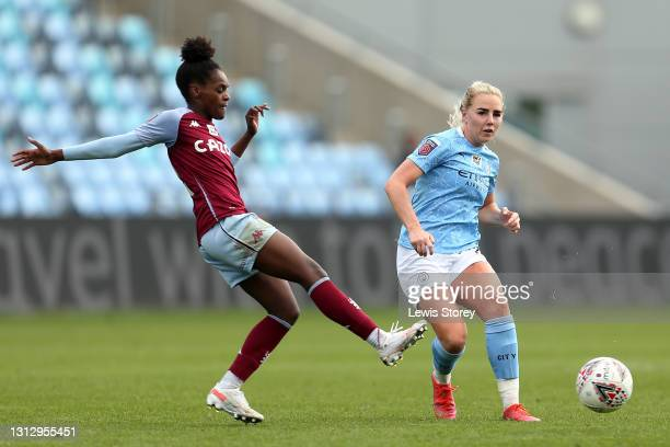 Alex Greenwood of Manchester City passes the ball under pressure from Diana Silva of Aston Villa during the Vitality Women's FA Cup Fourth Round...
