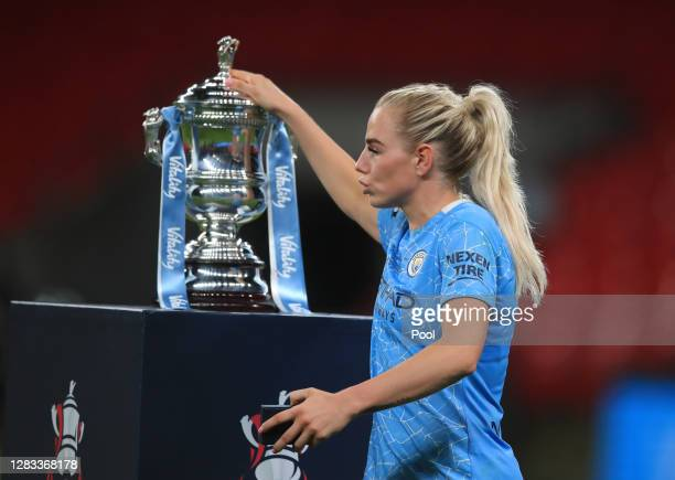 Alex Greenwood of Manchester City touches the Vitality Women's FA Cup Trophy as she walks past with her winners medal following the Vitality Women's...