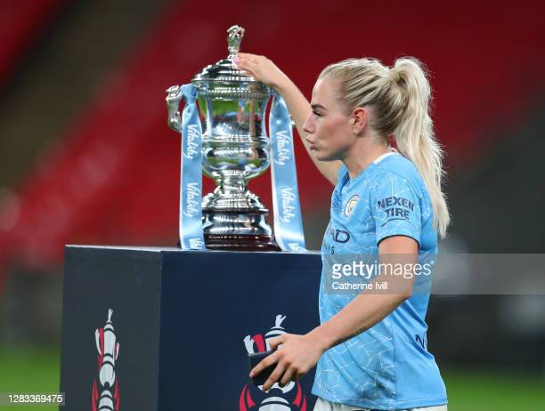 Alex Greenwood of Manchester City touches the Vitality Women's FA Cup Trophy as she walks past with her winners medal following her team's victory in...