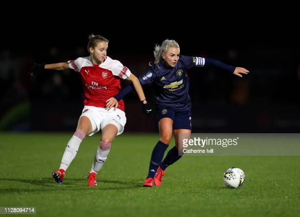 Alex Greenwood of Manchester United holds off Vivianne Miedema of Arsenal during the FA WSL Continental Tyres Cup semi final between Arsenal Women...