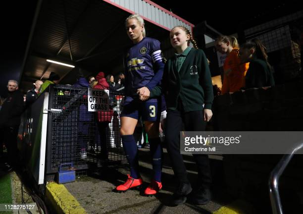 Alex Greenwood of Manchester United leads the team out with a mascot prior to the FA WSL Continental Tyres Cup semi final between Arsenal Women and...