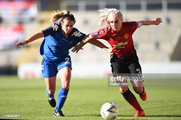 Alex Greenwood of Manchester United Women and Charley Boswell of Lewes Women in action during the Women's Super League match between Manchester...