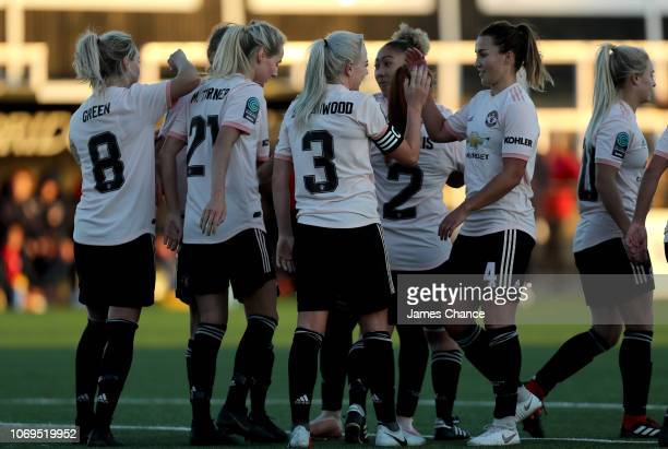 Alex Greenwood of Manchester United Women celebrates after scoring her team's fourth goal with Amy Turner of Manchester United Women during the FA...