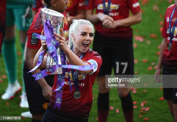 Alex Greenwood of Manchester United Women celebrates after they win Women's Super League 2 trophy after the match between Manchester United Women and...