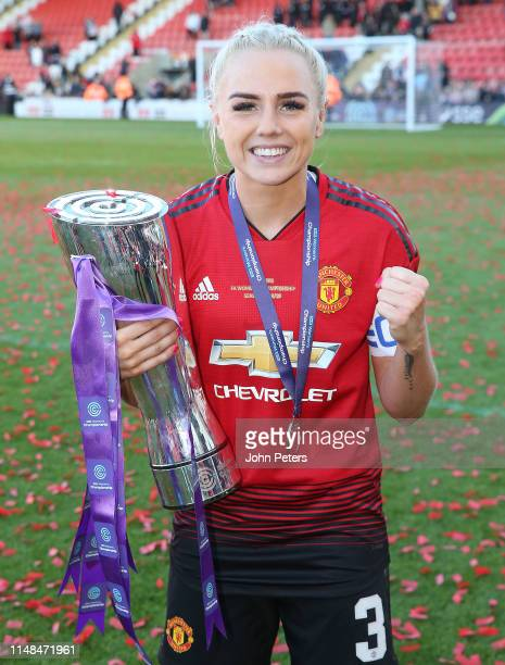 Alex Greenwood of Manchester United Women poses with the FA Women's Championship trophy after the WSL match between Manchester United Women and Lewes...