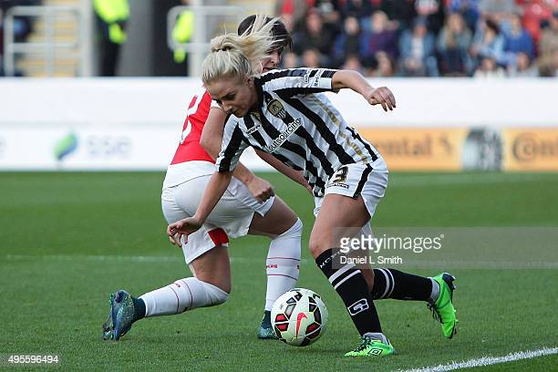 Alex Greenwood of Notts Ladies FC maintains control over Marta Corredera of Arsenal Ladies FC during the WSL Continental Cup Final between Arsenal...