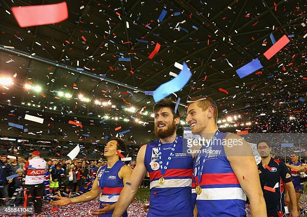 Alex Greenwood Tom Campbell and Liam Jones of Footscray celebrate winning the VFL Grand Final match between Footscray and Box Hill at Etihad Stadium...