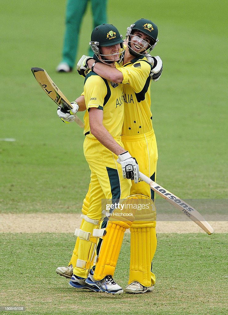 Alex Gregory (r) and Ashton Turner of Australia celebrate winning the ICC U19 Cricket World Cup 2012 Semi Final match between Australia and South Africa at Tony Ireland Stadium on August 21, 2012 in Townsville, Australia.