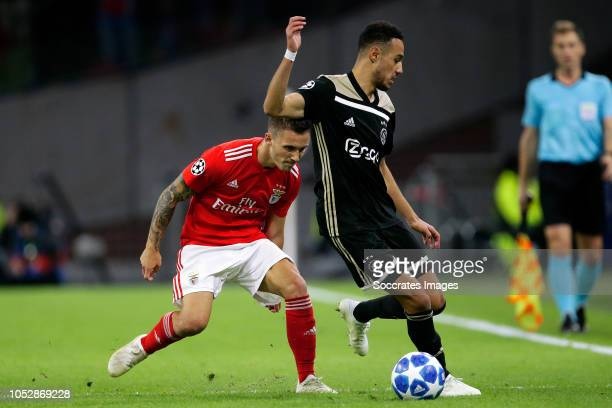 Alex Grimaldo of Benfica Noussair Mazraoui of Ajax during the UEFA Champions League match between Ajax v Benfica at the Johan Cruijff Arena on...