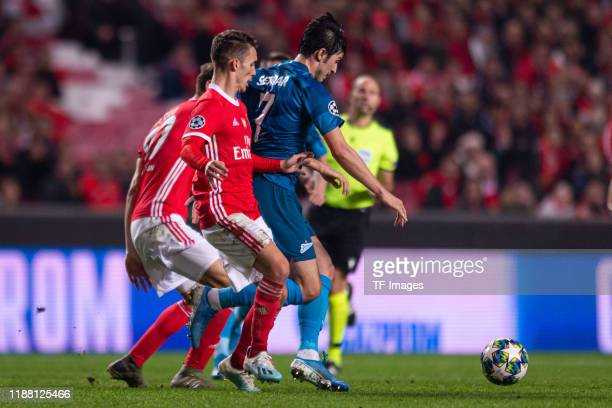 Alex Grimaldo of SL Benfica and Sardar Azmoun of Zenit St Petersburg battle for the ball during the UEFA Champions League group G match between SL...