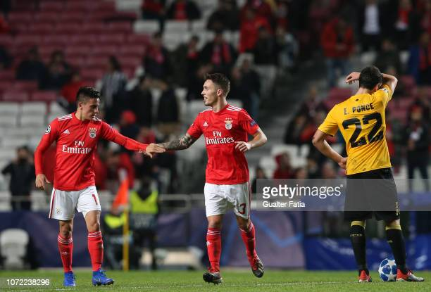Alex Grimaldo of SL Benfica celebrates with teammate Franco Cervi of SL Benfica after scoring the opening goal during the UEFA Champions League Group...