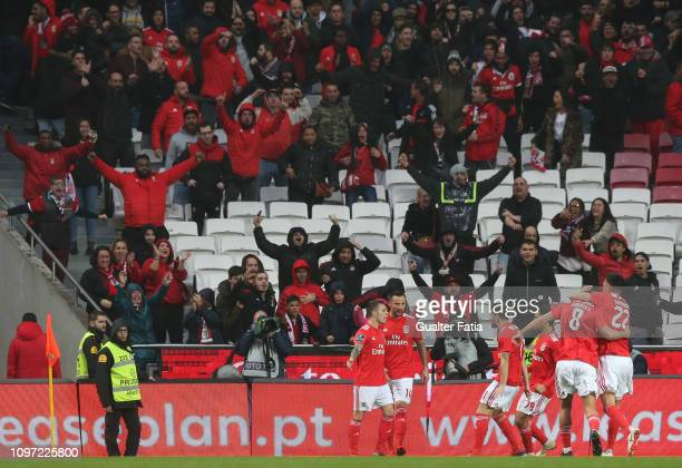 Alex Grimaldo of SL Benfica celebrates with teammates after scoring a goal during the Liga NOS match between SL Benfica and CD Nacional at Estadio da...