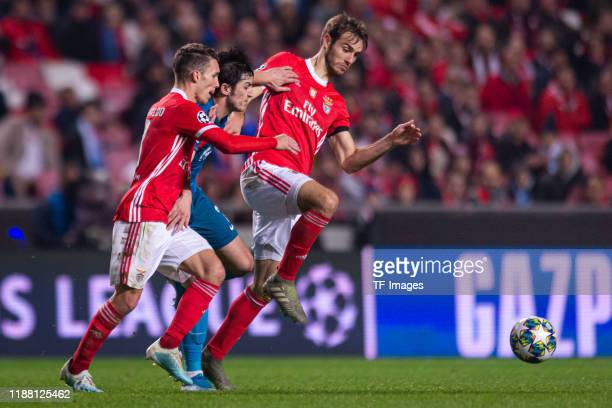 Alex Grimaldo of SL Benfica Sardar Azmoun of Zenit St Petersburg and Ferro of SL Benfica battle for the ball during the UEFA Champions League group G...
