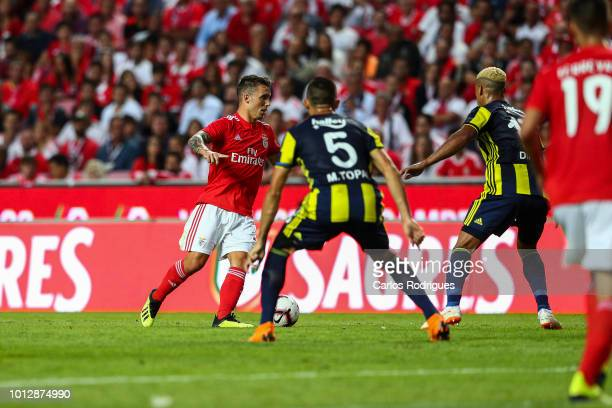 Alex Grimaldo of SL Benfica tries to escape Mehmet Topal of Fenerbache SK and Nabil Dirar of Fenerbache SK during the match between SL Benfica and...