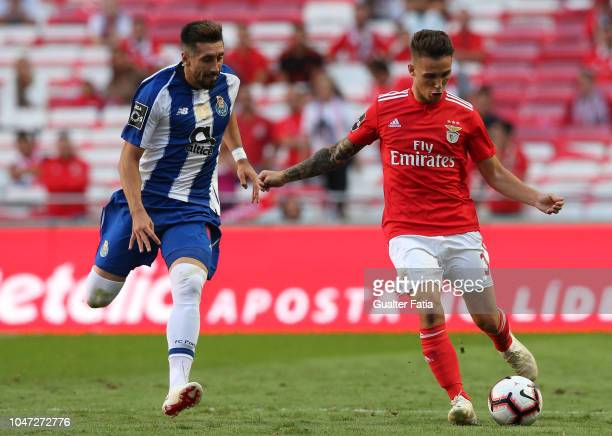 Alex Grimaldo of SL Benfica with Hector Herrera of FC Porto in action during the Liga NOS match between SL Benfica and FC Porto at Estadio da Luz on...