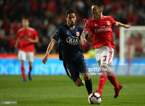 Alex Grimaldo of SL Benfica with Lica of Belenenses SAD in action during the Liga NOS match between SL Benfica and Belenenses SAD at Estadio da Luz...