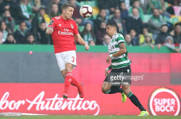 Alex Grimaldo of SL Benfica with Raphinha of Sporting CP in action during the Liga NOS match between Sporting CP and SL Benfica at Estadio Jose...