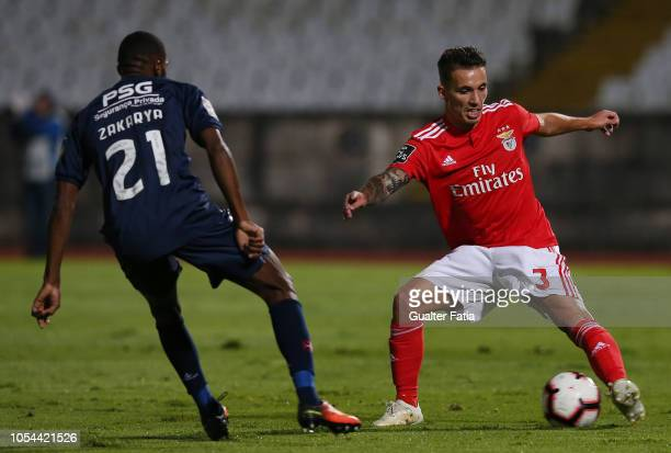 Alex Grimaldo of SL Benfica with Zakarya Bergdich of Belenenses SAD in action during the Liga NOS match between Belenenses SAD and SL Benfica at...