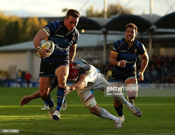 Alex Grove of Worcester is tackled by Mouritz Botha of Newcastle during the Aviva Premiership match between Worcester Warriors and Newcastle Falcons...