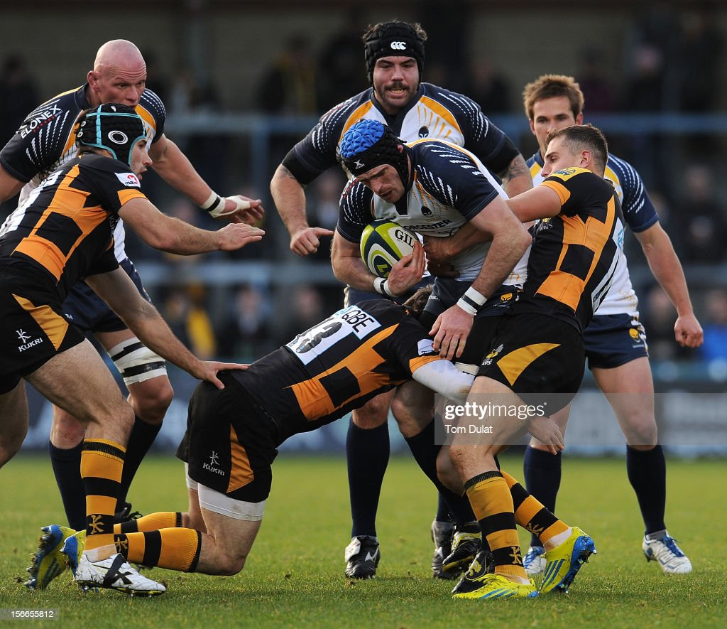 Alex Grove of Worcester Warriors is tackled by Jack Wallace (R) of London Wasps during the LV= Cup match between London Wasps and Worcester Warriors at Adams Park on November 18, 2012 in High Wycombe, England.