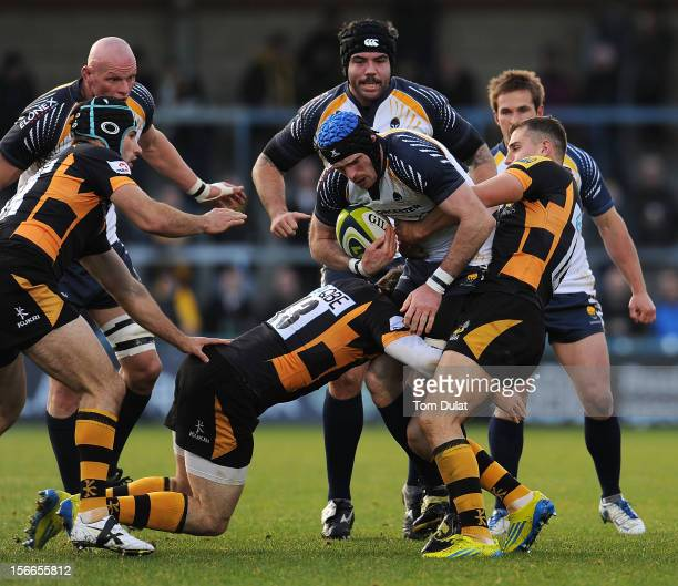 Alex Grove of Worcester Warriors is tackled by Jack Wallace of London Wasps during the LV= Cup match between London Wasps and Worcester Warriors at...