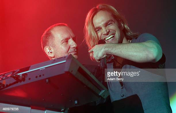 Alex Gruenwald and Tim Wilhelm of Muenchener Freiheit perform during a concert at Columbiahalle on January 30, 2014 in Berlin, Germany.