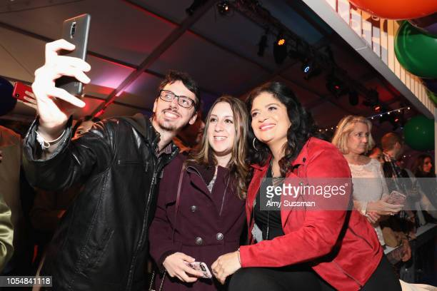 Alex Guarnaschelli takes a selfie with guests during Food Network's 25th Birthday Party Celebration at the 11th annual New York City Wine Food...