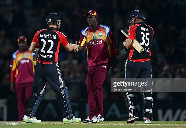 Alex Hales and Craig Kieswetter of England are congratulated by West Indies captain Darren Sammy during the NatWest International Twenty20 Match...