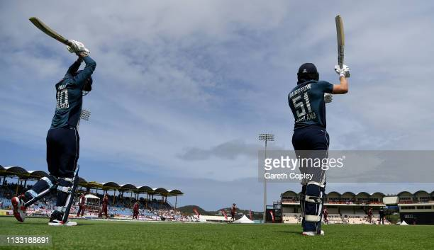 Alex Hales and Jonathan Bairstow of Englang walk out to bat ahead of the Fifth One Day International match between England and West Indies at Darren...