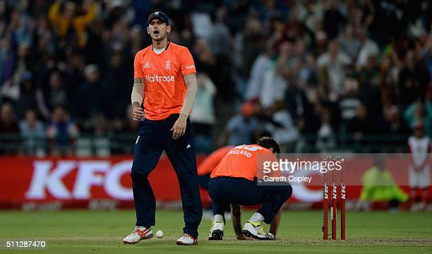 Alex Hales and Reece Topley of England react missing a run out chance to win the 1st KFC T20 International match between South Africa and England at...