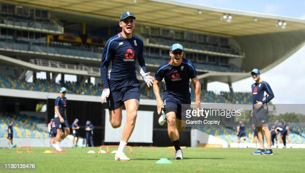 Alex Hales and Tom Curran of England take part in a sprits drill during a nets session at The Kensington Oval on February 16, 2019 in Bridgetown,...