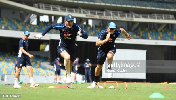 Alex Hales and Tom Curran of England take part in a sprits drill during a nets session at The Kensington Oval on February 16 2019 in Bridgetown...