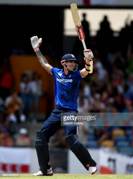 Alex Hales of England celebrates reaching his century during the 3rd One Day International between the West Indies and England at Kensington Oval on...