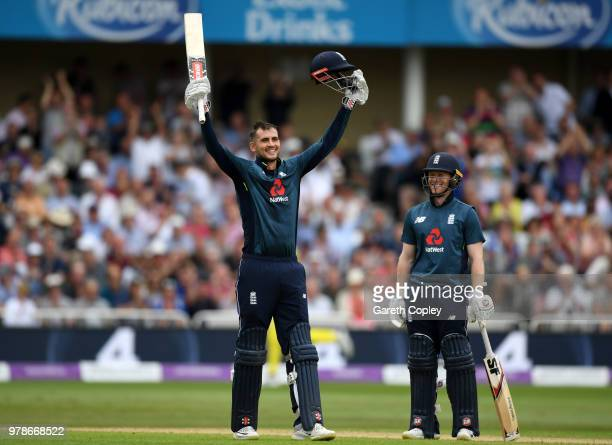 Alex Hales of England celebrates reaching his century with captain Eoin Morgan during the 3rd Royal London ODI match between England and Australia at...