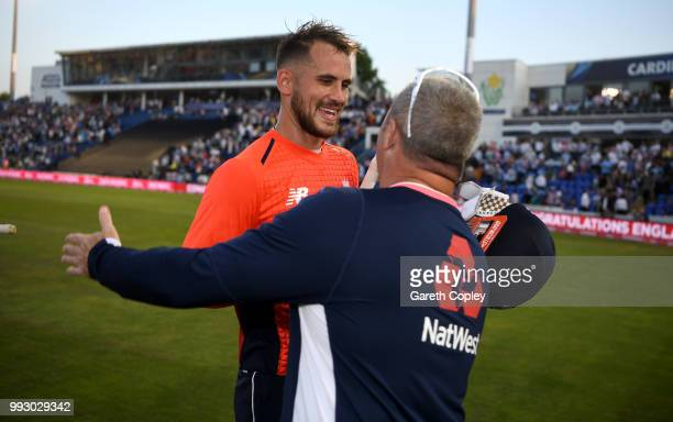 Alex Hales of England celebrates with coach Paul Farbrace after winning the 2nd Vitality International T20 match between England and India at SWALEC...