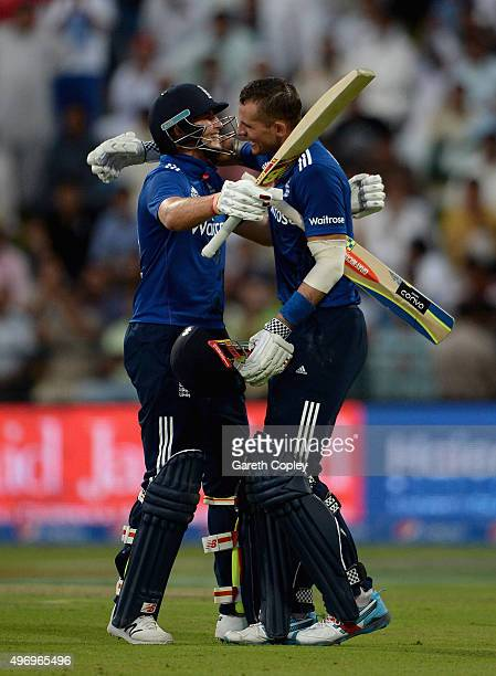 Alex Hales of England celebrates with Joe Root after reaching his century during the 2nd One Day International between Pakistan and England at Zayed...
