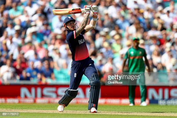 Alex Hales of England hits a six during the ICC Champions trophy cricket match between England and Bangladesh at The Oval in London on June 1 2017