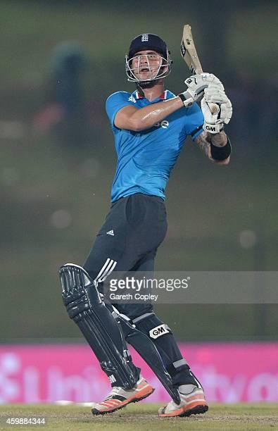 Alex Hales of England hits out for six runs during the 3rd One Day International between Sri Lanka and England at Mahinda Rajapaksa International...