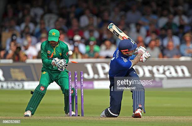 Alex Hales of England is bowled as Pakistan wicket keeper Sarfraz Ahmed looks on during the 2nd One Day International at Lord's Cricket Ground on...