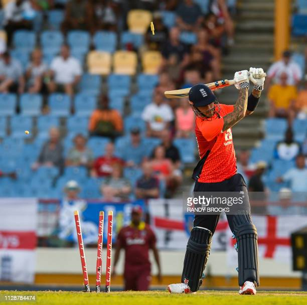Alex Hales of England is bowled by Sheldon Cottrell of the West Indies during a T20 match between the West Indies and England at Darren Sammy Cricket...