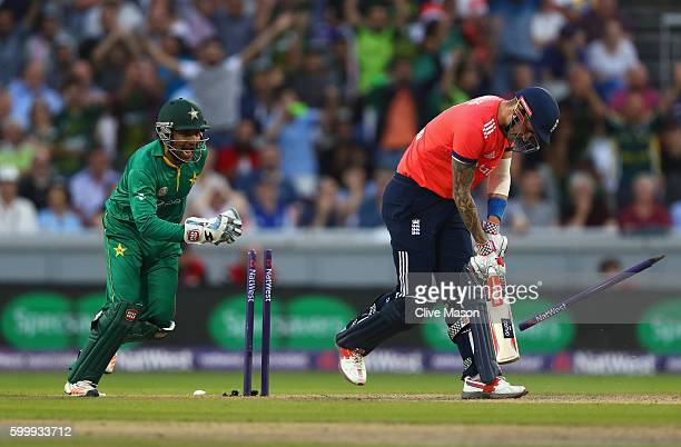 Alex Hales of England is dismissed off the bowling of Wasim Imad of Pakistan as wicketkeeper Ahmed Sarfraz of Pakistan celebrates during the NatWest...