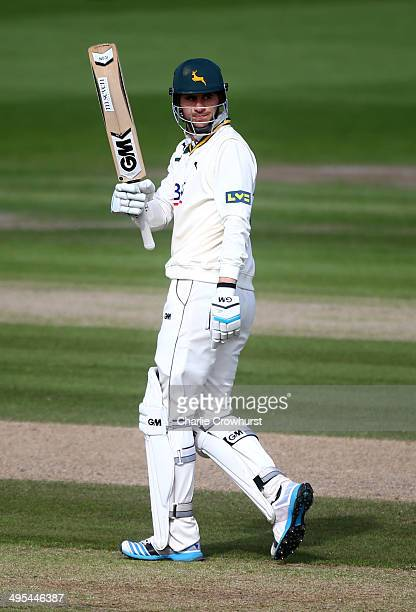 Alex Hales of Nottinghamshire celebrates making a century and a half during day three of the LV County Championship match between Sussex and...