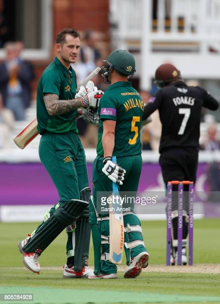 Alex Hales of Nottinghamshire is congratulated by teammate Steven Mullaney after reaching a century during the match between Nottinghamshire and...