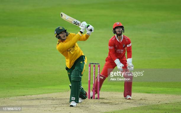 Alex Hales of Notts Outlaws hits runs watched on by Alex Davies during the Vitality T20 Blast Semi Final between Notts Outlaws and Lancashire...