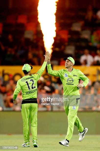 Alex Hales of the Thunder celebrates a catch to dismiss D'arcy Short of the Hobart Hurricanes off the bowling of Nathan McAndrew of the Thunder...