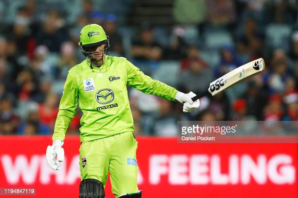 Alex Hales of the Thunder celebrates after reaching 50 runs during the Big Bash League match between the Melbourne Renegades and the Sydney Thunder...