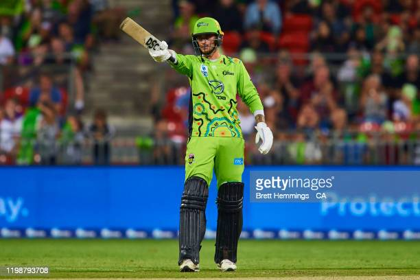 Alex Hales of the Thunder celebrates after scoring a half century during the Big Bash League match between the Sydney Thunder and the Hobart...